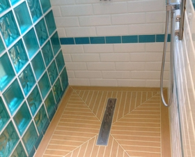 Shower base in teak finish with cream caulking